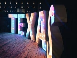 Lighted sign that spells TEXAS.