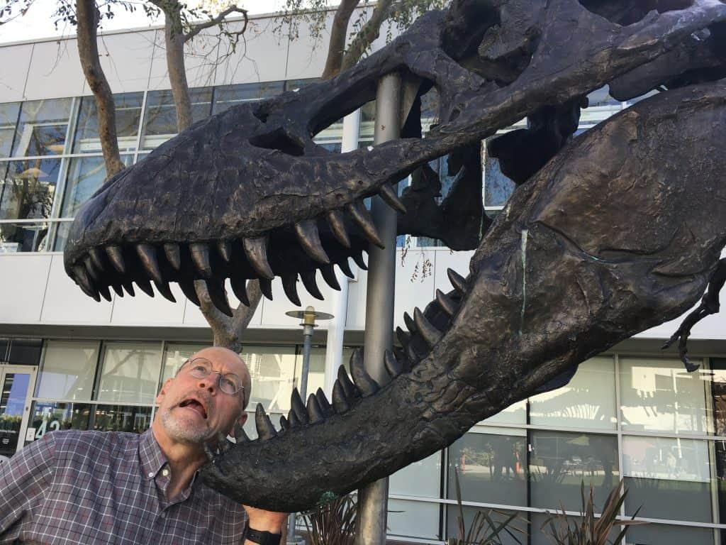 Van being eaten by a dinosaur skull.