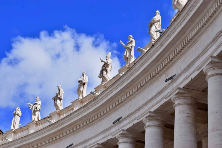 On the square of St. Peter's, statues of saints line the columned walls before entering the basilica. Some of these statutes were created as early as 1662.
